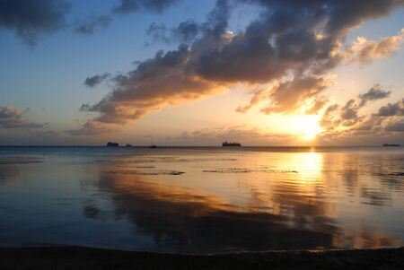 Photo pour Stunning sunset and gorgeous clouds reflected in the lagoon of Saipan, Northern Mariana Islands. - image libre de droit