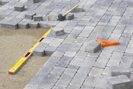 Photo for Paving Backyard patio with level and line - Royalty Free Image