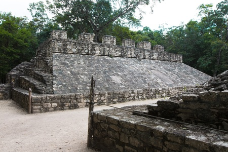 Deadly game, Mayan Ball game at ballcourt, ancient stone goal attached to the pyramid structure.