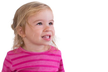 Beautiful toddler giving toothy smile