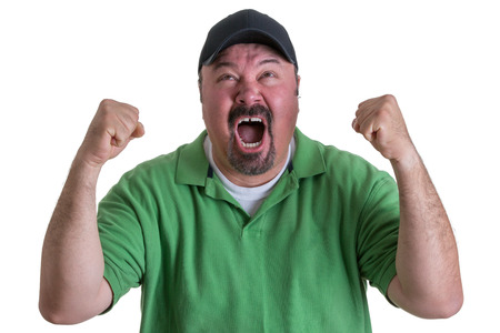 Excited Overweight Man Wearing Green Shirt and Black Baseball Cap Celebrating, Pumping Fists and Cheering in Studio with White Background