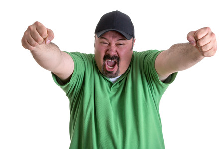 Happy Portrait of a Bearded Adult Man, in Casual Green Shirt with Cap, Screaming Out While Raising his Arms After his Team Wins. Isolated on White