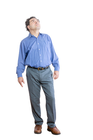 Full Length Shot of a Pensive Middle-Aged Office Man Looking Up High Against White Background.