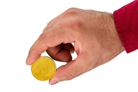 Close up view of hand holding golden cryptocurrency coin against white background