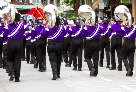 marching band during parade on the celebration