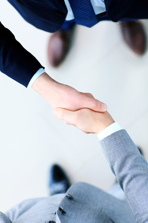 Closeup of a business handshake の写真素材