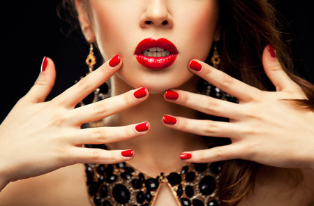 Photo pour Red Sexy Lips and Nails closeup. Open Mouth. Manicure and Makeup. Make up concept. Half of Beauty model girl - image libre de droit