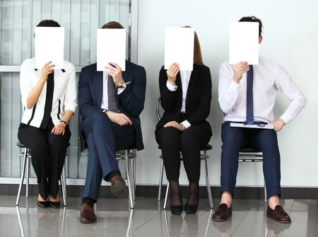 Foto de Human resource concept, Young businessman holding white billboard and waiting for job interview - Imagen libre de derechos