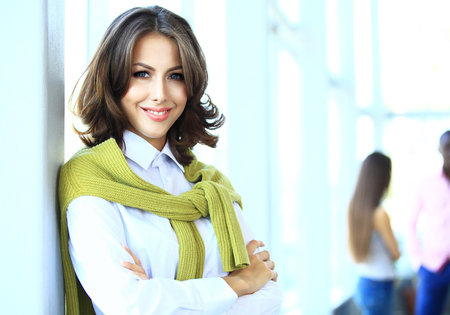 Photo for Face of beautiful woman on the background of business people - Royalty Free Image