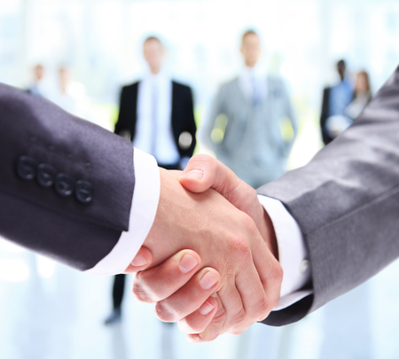 Closeup of a business handshake. Business people shaking hands, finishing up a meeting