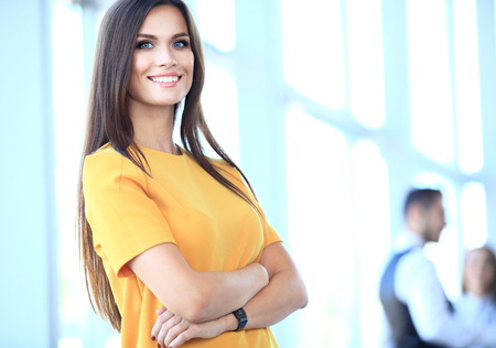 Foto de business woman with her staff, people group in background at modern bright office indoors - Imagen libre de derechos