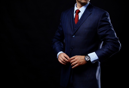 man in suit on a black background