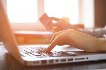 Photo pour Close Up Of woman Shopping Online Using Laptop With Credit Card - image libre de droit