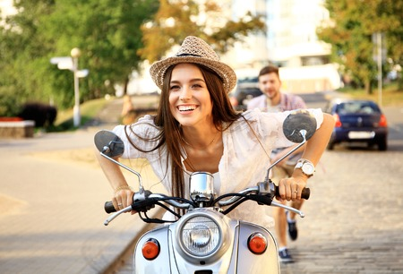 Photo pour Handsome guy and young woman ride motorcycles - image libre de droit