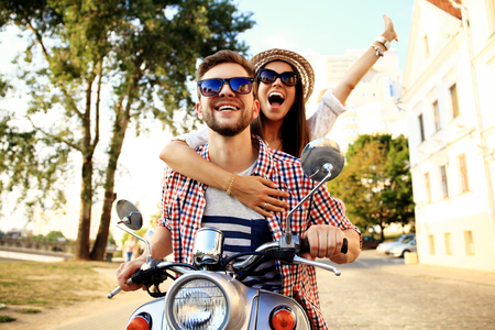 Photo pour Couple in love riding a motorbike - image libre de droit