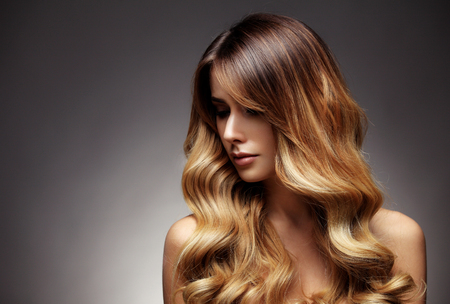 Beautiful blonde woman with long, healthy , straight and shiny hair. Hairstyle loose hairの写真素材