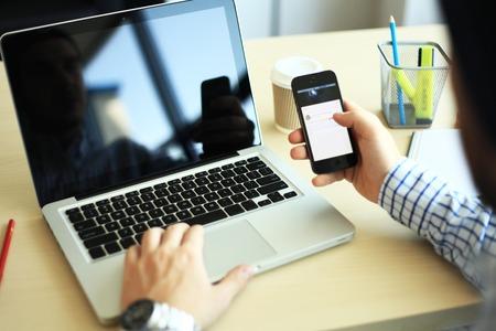 Photo pour business man using internet on smart phone and laptop - image libre de droit
