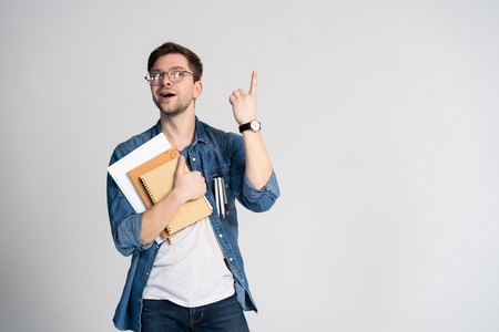 Foto de I have got brilliant idea. Caucasian cheerful man, raises index finger, has intriguing plan isolated over white background with copy space - Imagen libre de derechos