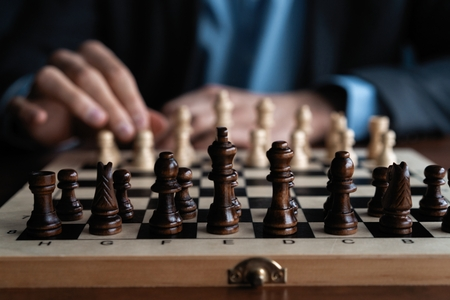 Photo pour Businessman play with chess game. concept of business strategy and tactic. - image libre de droit