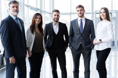 Foto de Full length confident business team stands in office. - Imagen libre de derechos