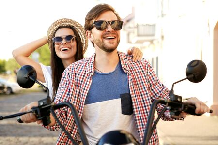 Photo pour Couple in love riding a motorbike , Handsome guy and young sexy woman travel . Young riders enjoying themselves on trip. Adventure and vacations concept. - image libre de droit