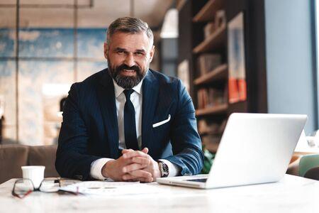 Photo pour business man working with documents and laptop - image libre de droit