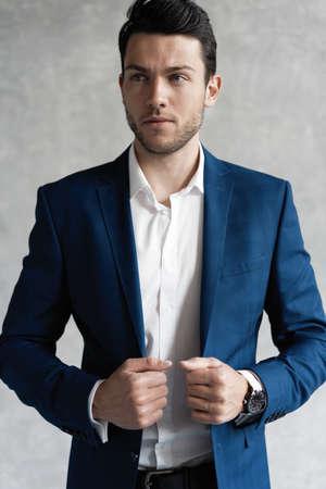 Photo pour Handsome man wear blue suit isolated on grey background. - image libre de droit