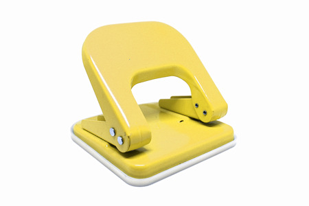 Photo for Yellow office paper hole puncher isolated on white background. - Royalty Free Image
