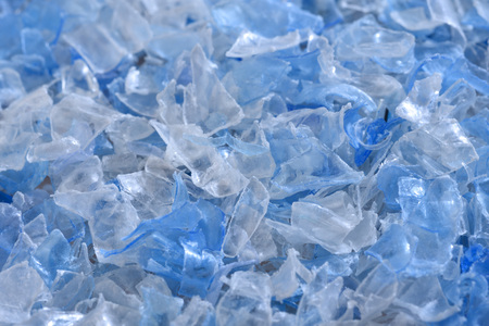 Photo for Flakes of crushed plastic bottles as raw material for further processing. - Royalty Free Image
