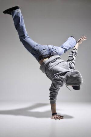 Caucasian boy practice break dance, street urban dance