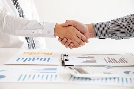 Photo pour Two business leader discussing the charts and graphs showing the results Planning to start new strategy for big success and catchhand. - image libre de droit