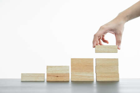Photo pour Hands of businesswomen playing wooden block game. Concept Risk of management and strategy plans for business growth and success. - image libre de droit