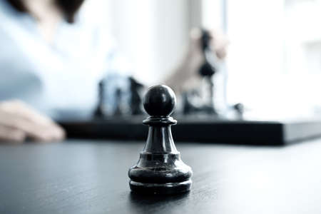 Photo for The hands of businesswomen moving chess in chess competitions demonstrate leadership, followers, and strategic plans, business success building processes, and teamwork. - Royalty Free Image