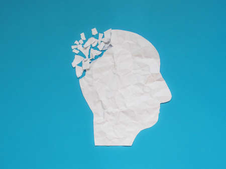 Photo pour Brain disorder symbol presented by human head made form crumpled paper torn on blue background. Creative idea for Alzheimer's disease, dementia, memory loss and mental health treatment concept. - image libre de droit