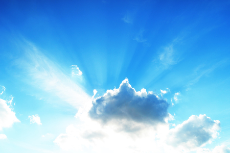 Photo pour Sun high in the sky with sprouting rays in front of clouds - image libre de droit
