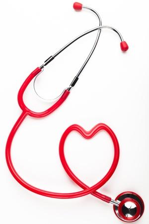 Single red stethoscope heart shaped  isolated on white background
