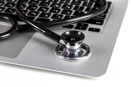 Photo for Black Stethoscope Closeup On Silver Laptop  With White Background - Royalty Free Image