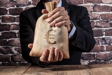 Man holding a big sack of money