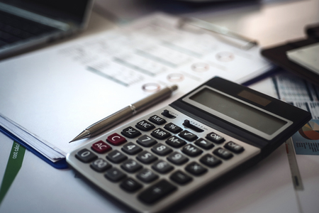 Photo pour Calculator for Invoice on workplace of accountant Business. Accounting concept. - image libre de droit