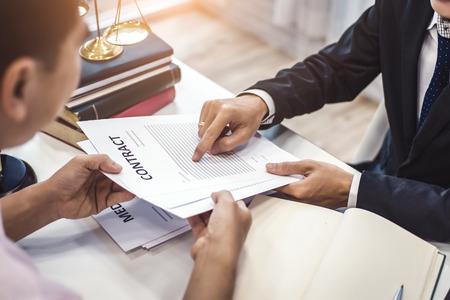 Photo pour Male lawyer explain a contract agreement to client for law .Law and Legal services concept. - image libre de droit