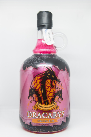 Bottle of bright pink alcoholic beverage called Dracarys inspired by the TV series Game of Thrones.
