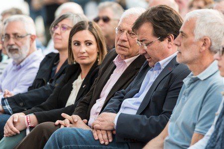 Josep Borrel, candidate for PSOE in the European elections, seated with other local leaders during the rally in Caceres.