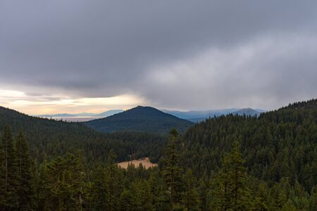 Forest and mountain landscape on a rainy day seen from Crater Lake