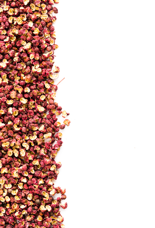 Streak of sichuan chinese pepper isolated on white background as image backgrounds