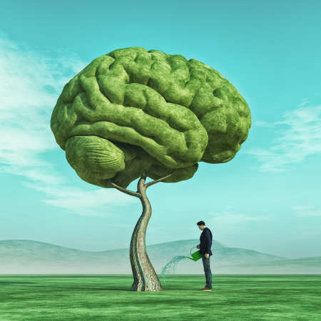 Foto de Conceptual image of a man squirting a big tree shaped human brain on a green field.   This is a 3d render illustration. - Imagen libre de derechos