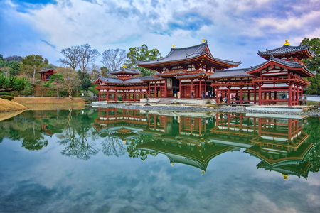 Kyoto, Japan- December 31, 2015: Byodo-in is a Buddhist temple in the city of Uji in Kyoto Prefecture, Japan. It is jointly a temple of the Jodo-shu (Pure Land) and Tendai-shu sects.
