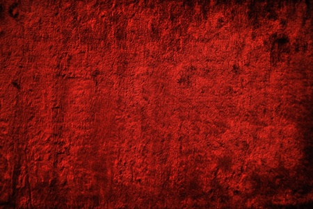 Red velvet cloth. The texture of velvet.