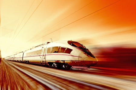 High-speed train in motion  The red tones  Sunset