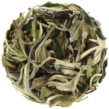 Yunnan Bai Mu Dan Early Spring White Tea round shape isolated