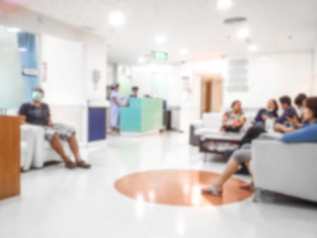 Photo pour Blur background the  patient waiting doctor for treatment in hospital. - image libre de droit
